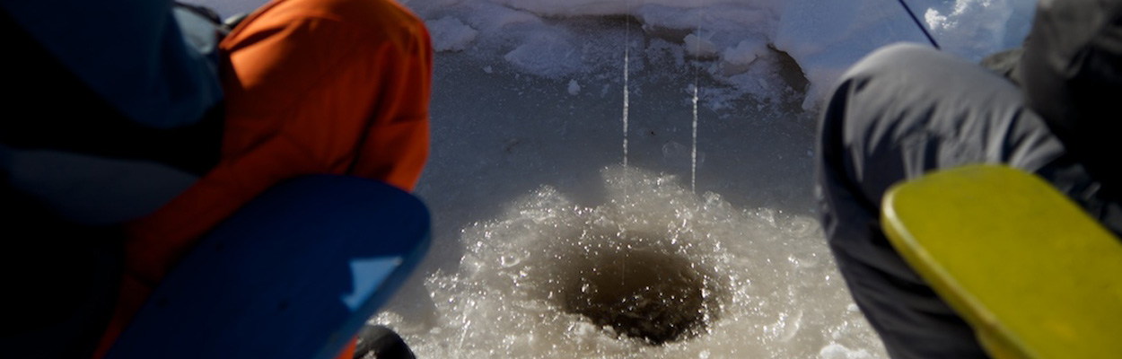 Ice fish hole 1250x400 - Ice Fishing in Ontario's Lake Country
