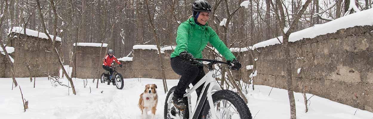 Bat Biking Women Dog 1250x400 - Maple Tours and Winter Fun in Ontario's Lake Country